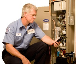 Technician inspecting furnace