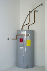 Traditional electric water heater.