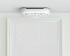 A NEST Protect Smoke Alarm mounted on the ceiling