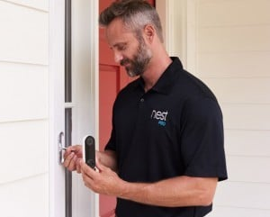 Man at front door ringing NEST Hello Doorbell