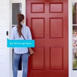 Woman at front door using NEST Hello Doorbell