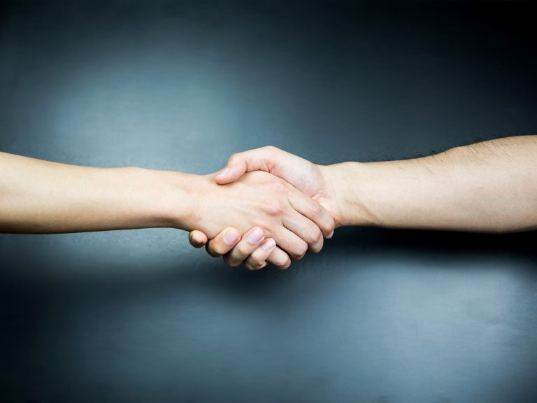 Handshake on blue background