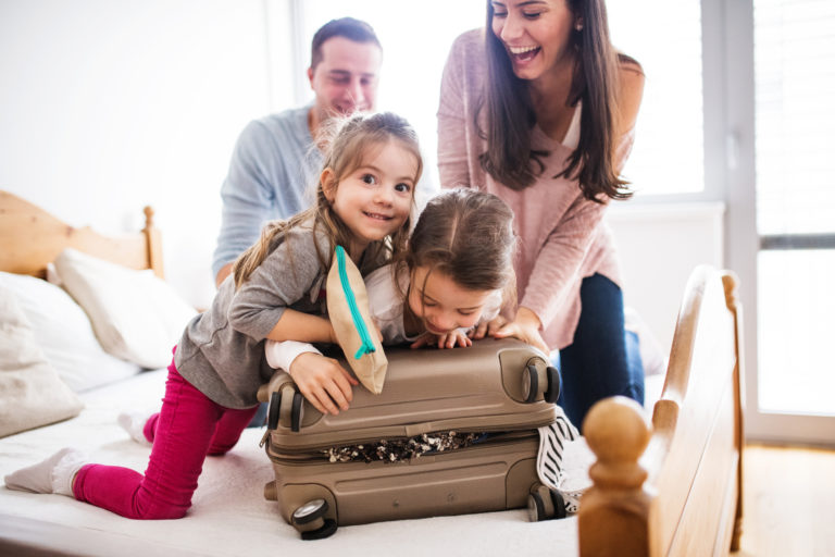 Young family with two children packing for holiday