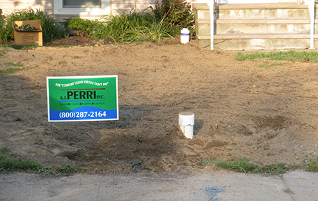 A yard showing final grading after installing a sewer line